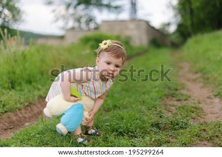 pensive girl holding teddy bear