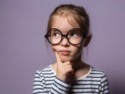 pensive little girl with glasses