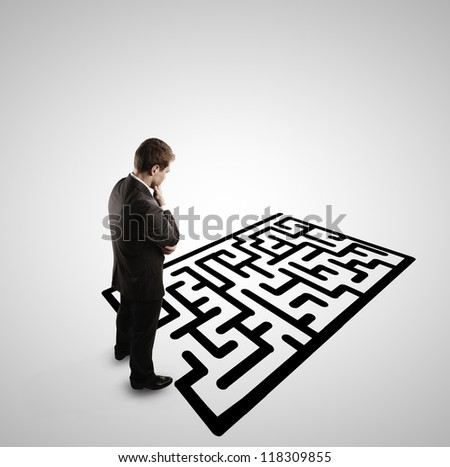 pensive man and  labyrinth on white background