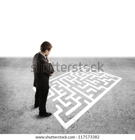 pensive man in front of labyrinth