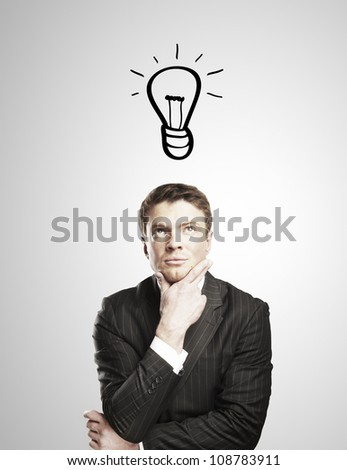 pensive man with a drawing lamps over his head