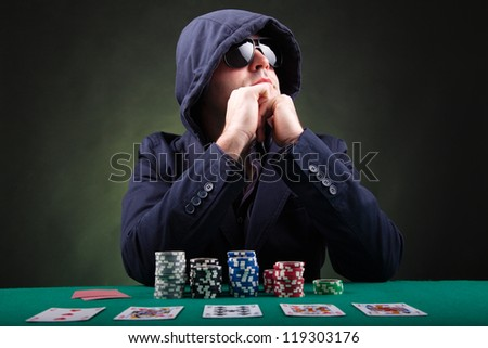 Pensive Poker player on black background