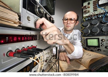Pensive scientist working at vintage technological laboratory