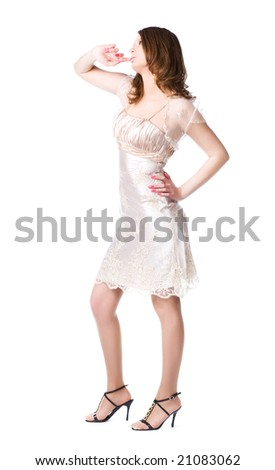 Pensive woman in silver dress. Isolated on white.