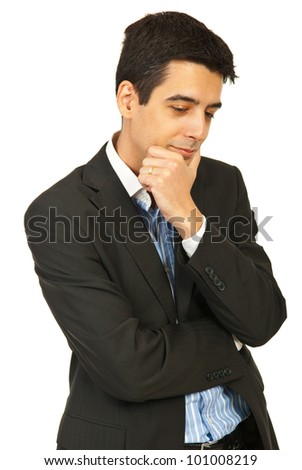 Pensive young business man looking down isolated on white background