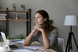 Pensive young Caucasian woman distracted form computer work read letter thinking pondering of problem. Thoughtful millennial female receive unpleasant news in document paperwork, make decision.
