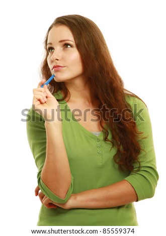 Pensive young college girl with pen looking at copyspace isolated - stock photo