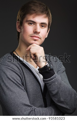 pensive young man in shirt
