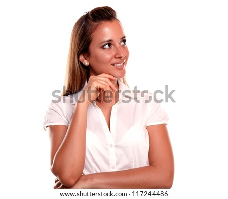 Pensive young woman looking to her left up on isolated background - copyspace