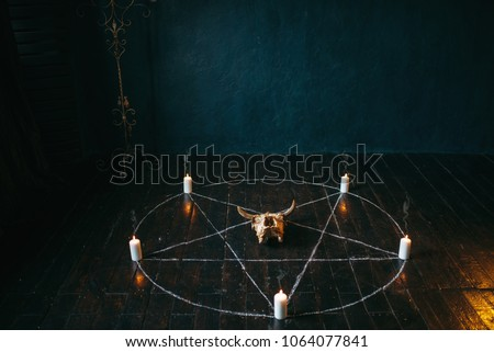 Pentagram circle with candles on wooden floor