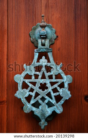 [Image: stock-photo-pentagram-knocker-on-a-woode...139298.jpg]