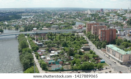 Penza, Russia. Penza city with residential areas and highway in a calm cold sunny day, a top view, in Penza, Russia. Cities Penza Russia, shot from high #1427889065