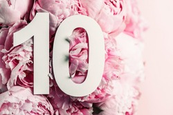 Peony flowers, digit ten. Birthday greeting card with inscription 10. Anniversary concept. Top view. White numeral on flower background. Numerical digit, Celebration event, template, flyer.