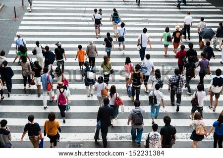 People across the crosswalk