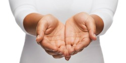 people and advertisement concept - close up of womans cupped hands showing something