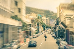 People and cars moving around on Longstreet in Cape Town downtown before sunset  - Commuters walking in south african business district - Radial zoom defocusing on a vintage filtered look