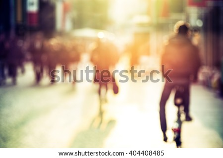 people and cyclist in the...