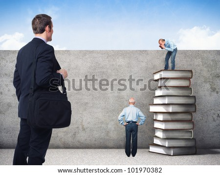 people and 3d image of book pile and grunge wall