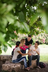 People and education, college students meeting and doing homework together in park