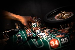 People and entertainment concept. Casino, gambling, poker,  roulete