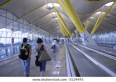 people and escalators in airport