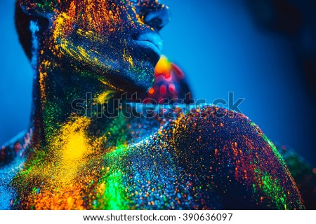 Stock Photo people are colored fluorescent powder. a pair of lovers dancing at a disco.