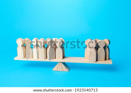 People are divided into two unequal groups on the scales. Concept of democracy and statistical surveys. Political process, democratic elections. Difference in opinions polls. Majority versus minority. Stock photo ©