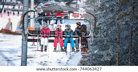 People are lifting on ski-lift for skiing in the mountains
