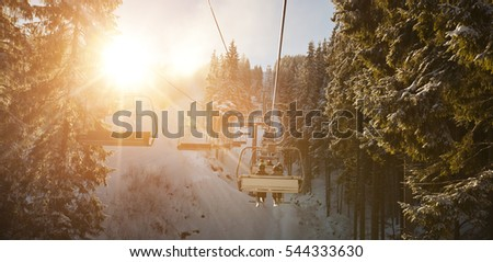 People are lifting on ski-lift in the mountains #544333630
