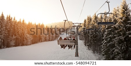 People are lifting on ski-lift in the mountains #548094721
