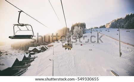 People are lifting on ski-lift in the mountains #549330655