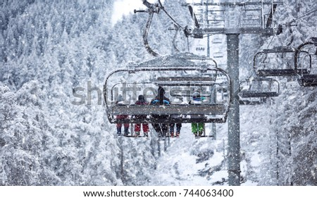 People are lifting on ski-lift -Skiing in high mountains on vacation