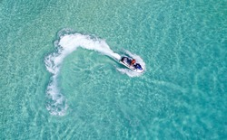 People are playing a jet ski in the sea.Aerial view. Top view.