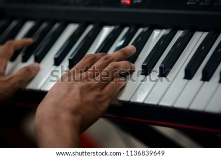People are playing keyboard instruments #1136839649