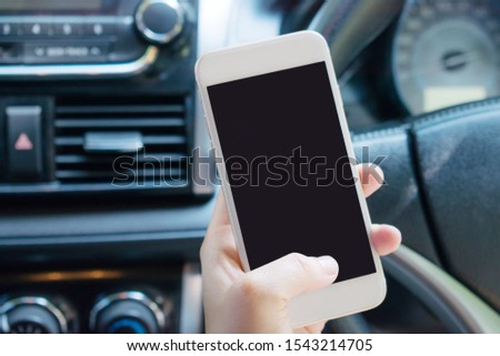 People are using a smartphone in their car for finding directions, traveling. Concept technology. Сток-фото ©
