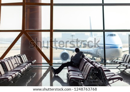 people are waiting for their flight #1248763768