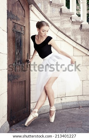 People art ballet. Beautiful young ballerina posing on emotional nature. Marble interior. Original unusual positions.