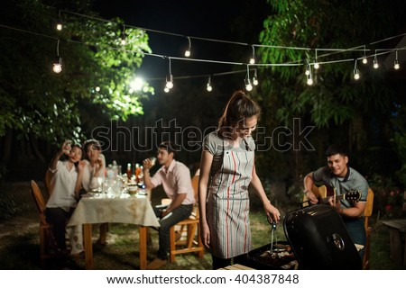 People asians barbecue party in the garden at night