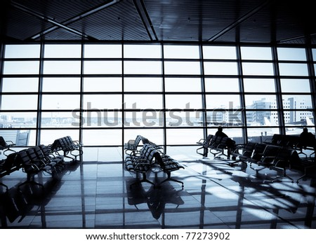 People at a modern airport, departure lounge