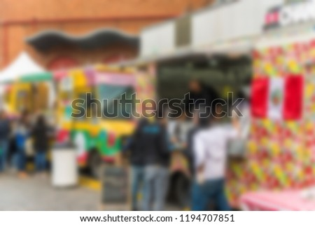 People at a street food market festival on a sunny day. Blurred on purpose. #1194707851