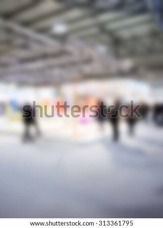 People at event, intentionally blurred post production background.