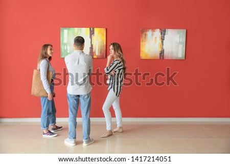 People at exhibition in modern art gallery Сток-фото ©