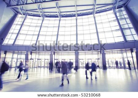 People at modern building walking around
