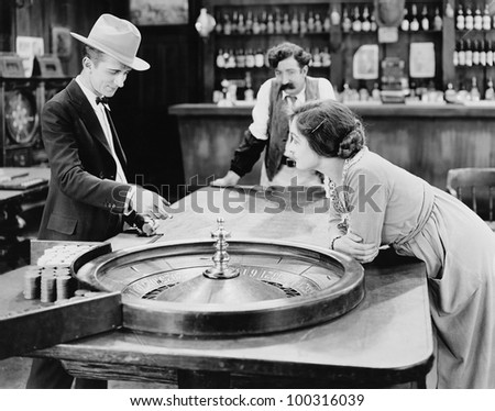 People at roulette table in bar