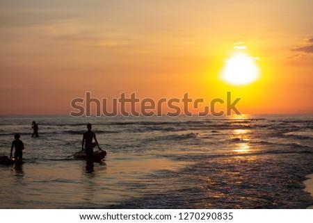 People at the beach in sundown