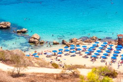 People at the famous beach of Konnos Bay Beach, Ayia Napa. Famagusta District, Cyprus.