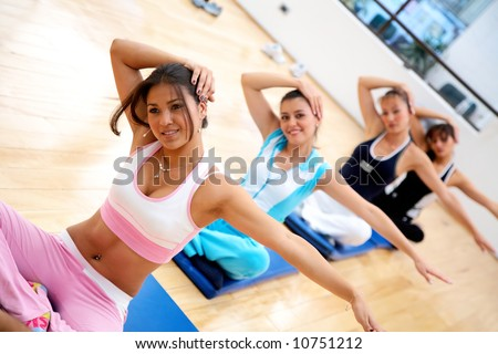 people at the gym during an aerobics class