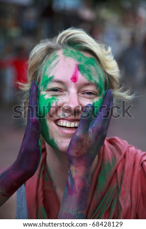 People at the holi festival in India. Holi, or Holli,is a spring festival celebrated by Hindus, Sikhs and others. People throwing coloured powder and coloured water at each other.