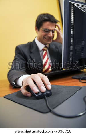 people at work: business man screaming at his PC. It got a virus