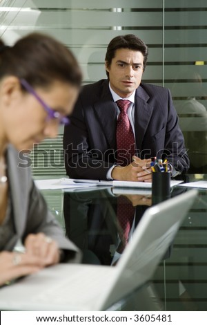 People at work: businesswoman working with laptop during a meeting
